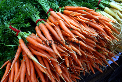 Stock photo of orange and red fresh carrots at the market.